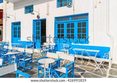 Typical Greek tavern in Little Venice, a part of Mykonos town on island of Mykonos, Greece - stock photo