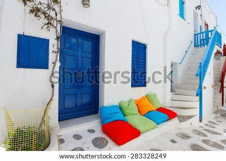 Typical greek traditional village with white walls and colorful doors, windows and balconies on Mykonos Island, Greece, Europe - stock photo