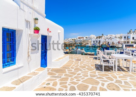 Typical Greek white church building in Naoussa port, Paros island, Cyclades, Greece - stock photo