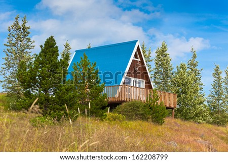 Typical Holiday House at North Iceland. Horizontal shot - stock photo
