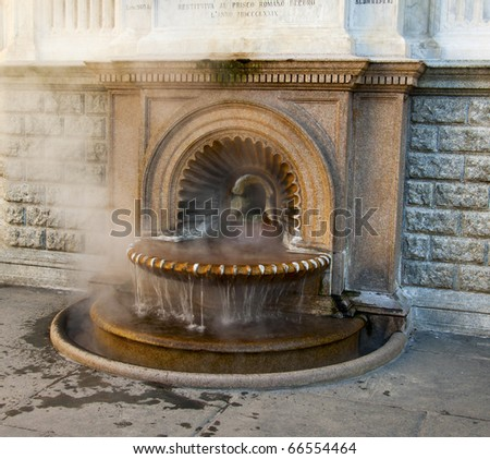 "Typical hot water fountain ""La Bollente"" (""the very hot one"") at the Italian city of Acqui Terme (Piedmont) - stock photo"