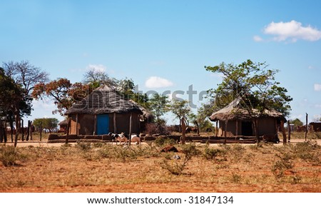 typical household from Southern Africa,Botswana, SouthAfrica, rondaveles with thatched roof - stock photo