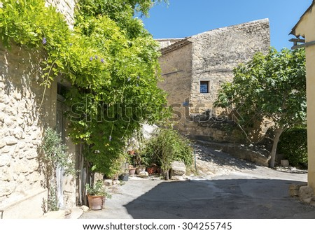typical houses and plants under the blue sky in the old mountain village of Ansouis, Provence, France, region Luberon - stock photo