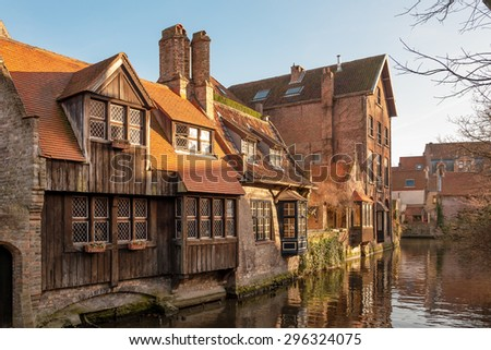 Typical houses around Dijver canal in historic center of Bruges - stock photo