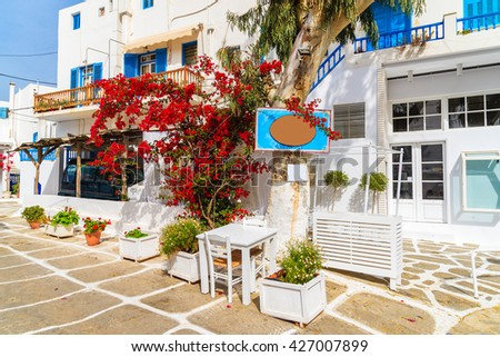 Typical houses decorated with flowers in Mykonos town on island of Mykonos, Cyclades, Greece
