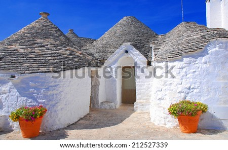 Typical houses of Alberobello, Puglia, Italy. Famous touristic destination. - stock photo