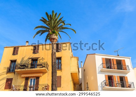 Typical houses with chairs on balconies in Bonifacio port, Corsica island, France - stock photo