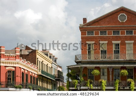 Typical houses with exquisite ironwork in French Quarter, New Orleans - stock photo