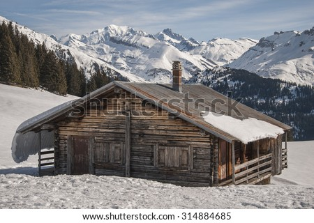 Typical hut and Mont Blanc massif. Alps, France - stock photo