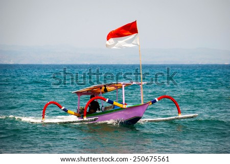 Typical indoensian boats called jukung on the beach of Lovina, Bali, Indonesia - stock photo