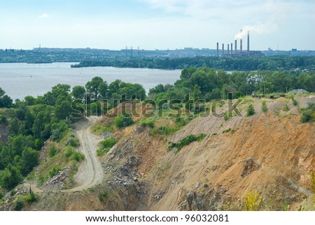 Typical industrial landscape in Ukraine - quarry beside big river Dnepr. - stock photo
