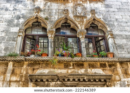 Typical istrian architecture: walls, houses, windows, stones and streets of Porec in Croatia