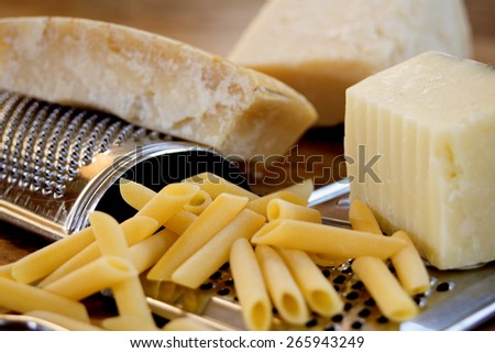 typical italian cheese: parmesan to grate for the pasta - stock photo