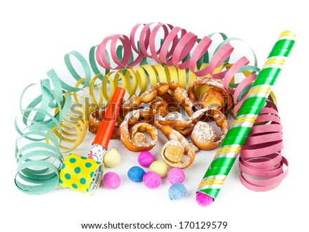 "Typical Italian dessert for carnival, ""chiacchiere"" fries with toys and confetti."