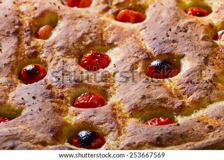 Typical Italian flat Bread, from Apulia region, made with Tomatoes and Oregano.  - stock photo