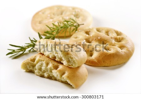 Typical Italian focaccia with rosemary on white background