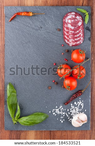 Typical Italian products on black board - stock photo