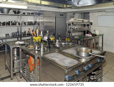 Typical kitchen of a restaurant shot in operation - stock photo