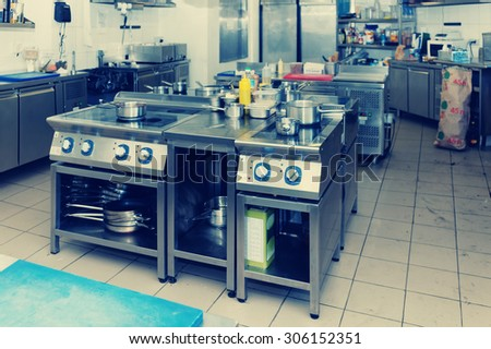 Typical kitchen of a restaurant, toned image - stock photo