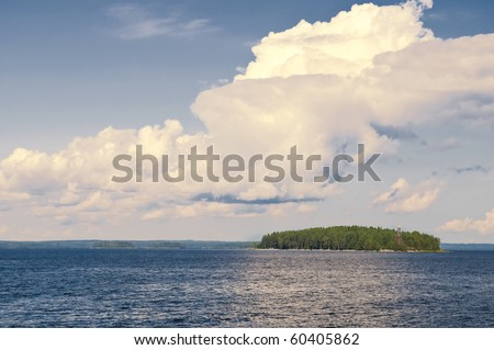 Typical landscape in Karelia - blue sky, clouds, big lake and a lot of distant green islands, trees, stones and rocks - stock photo