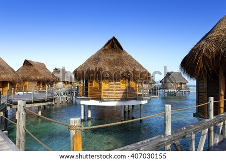 typical landscape of tropical islands - huts, wooden houses over water