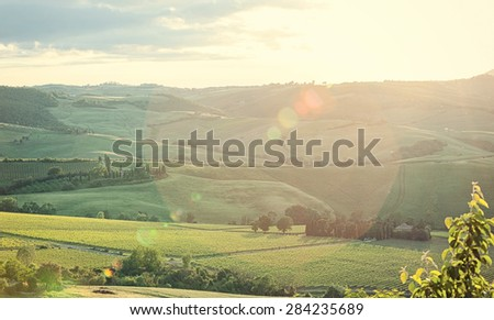 Typical landscape of Tuscany hills with lens flare - stock photo