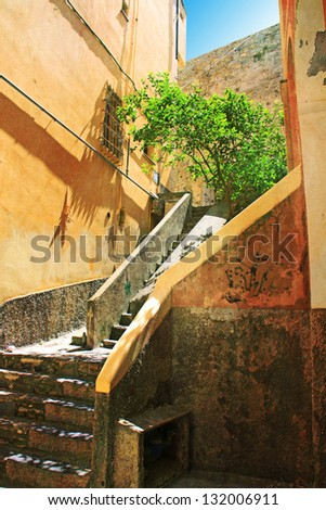 Typical ligurian landscape: a narrow staircase between house walls to climb uphill. - stock photo