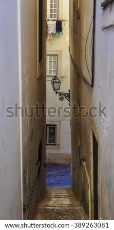Typical Lisbon city street with stairs and pavement