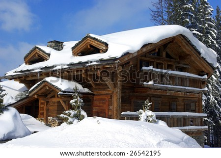 Typical luxurious chalet in a French ski resort. - stock photo
