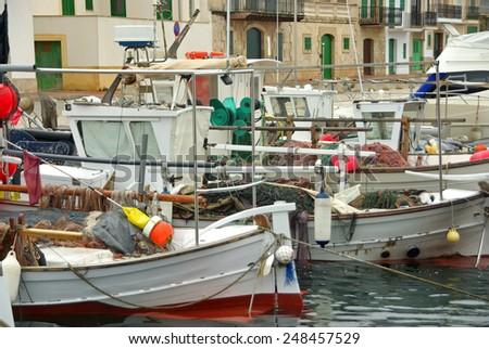 Typical mediterranean fisher boats in Porto Colom (Spain) - stock photo