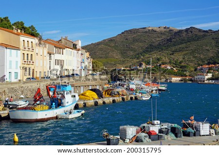Typical Mediterranean fishing port of Port-Vendres with the fort Bear in background, Roussillon, Pyrenees Orientales, France - stock photo