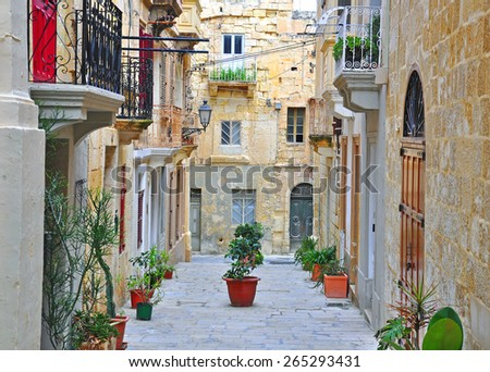 Typical Mediterranean patio: balconys, doors and walls in old town - stock photo