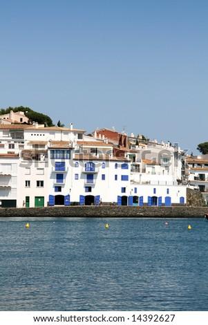 typical mediterranean village, white houses at the coast - stock photo