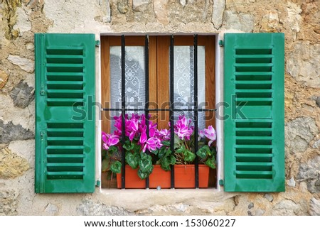 Typical mediterranean window in a house of the village of Deia in Majorca (Spain)