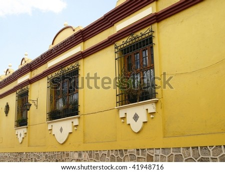 Typical Mexican house, low architecture, bright and vibrant