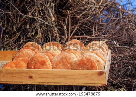 Typical Moroccan cheap bread, placed in a wooden box - stock photo