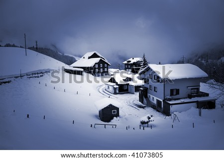 Typical mountain houses swiss view during winter season. - stock photo