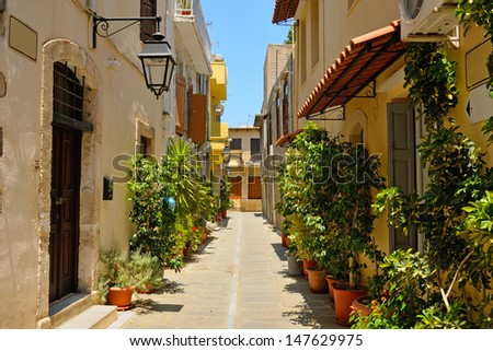 Typical narrow street in city of Rethymno, Crete, Greece - stock photo