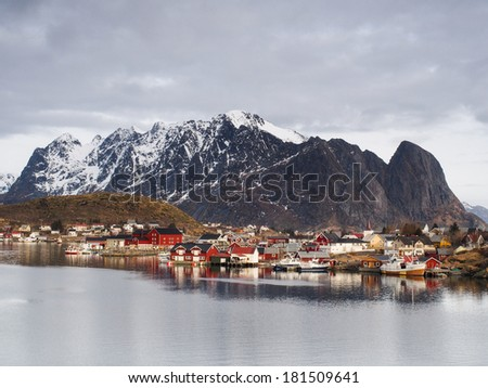 Typical norwegian fishing village with traditional red rorbu huts. Reine, Lofoten Islands, Norway