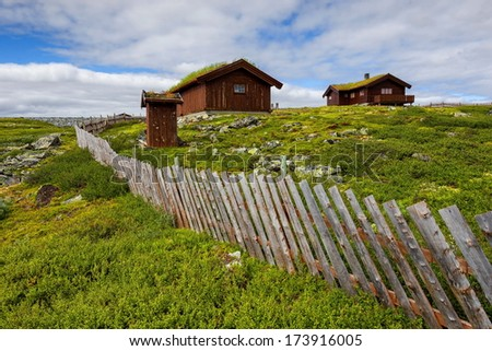 Typical Norwegian houses with outhouse, Norway - stock photo