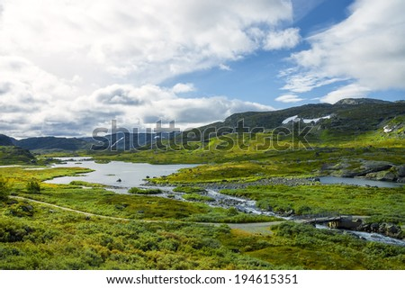 Typical Norwegian landscape. River, tundra, mountains, sunny valley. - stock photo