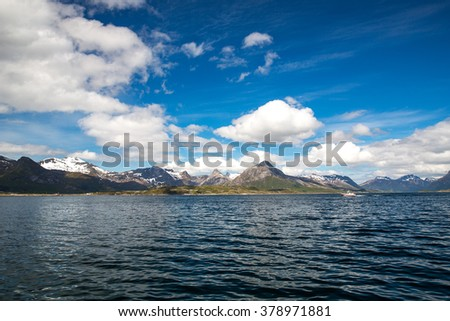 Typical norwegian landscape seen from a boat in Lofoten Islands, Norway. - stock photo