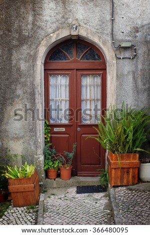 Typical old door in a alley of portuguese town of Sintra - stock photo