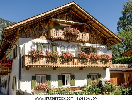 typical old farmhouse at the european alps - stock photo
