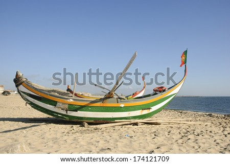 Typical old portuguese fishing boats on the beach of Espinho, Portugal