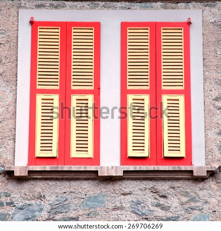 typical old red shutter windows in stone house, Italy. Square toned image - stock photo