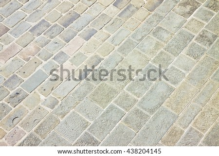 Typical old Tuscany paving made with carved stone blocks (Italy) - stock photo