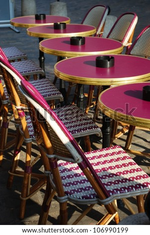 Typical outdoor cafe with tables and chairs on the sidewalk in Paris, France