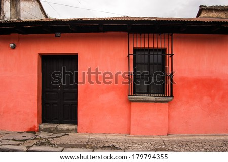 Typical painted colonial style house in UNESCO World Heritage Site, Antigua, Guatemala - stock photo