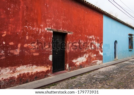 Typical painted colonial style houses in UNESCO World Heritage Site, Antigua, Guatemala - stock photo